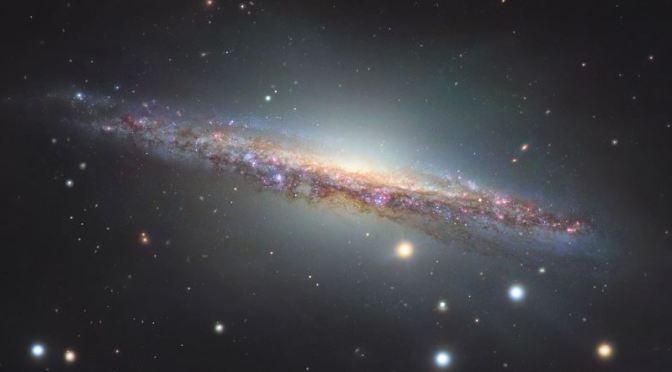 Lagran y hermosa galaxia espiral NGC 1055
