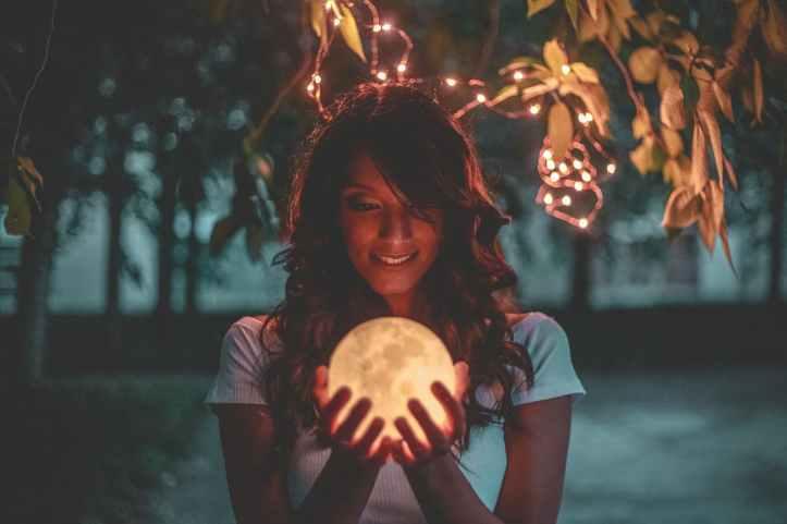 woman holding moon lamp